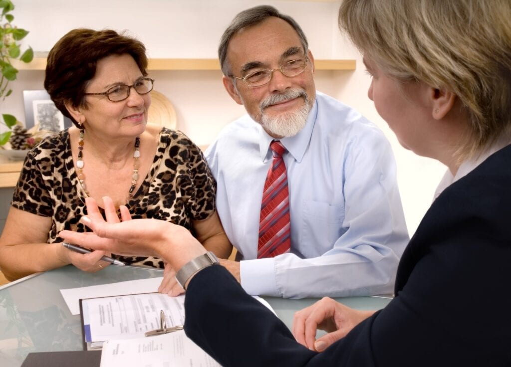 Elderly couple speaking with lawyer